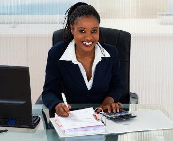 woman sitting in her desk